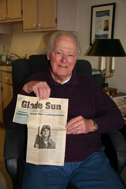 "Donald Brazones, Second Lieutenant in the U.S. Army Air Corp, holds an article from ""The Glade Sun"" community newspaper in Fairfield Glades, Tennessee, from Oct. 6, 1994 featuring him and his story of service to his country."