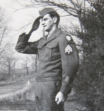 The three stripes on his shoulder identify McMurray as a Sergeant. This photo was taken at the time of his discharge.
