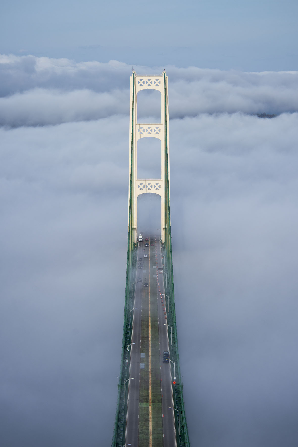 Scenic, Straits Of Mackinac, Mackinac Bridge, shot from the South Tower, looking at the North Tower in the directon of St. Ignace with heavy fog washing over the bridge deck.